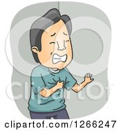 Asian Man Clutching His Chest During A Heart Attack