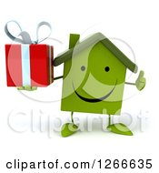 Clipart Of A 3d Happy Green House Character Holding A Gift And Thumb Up Royalty Free Illustration