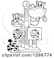 Clipart Of Four Black And White Cats Playing And Resting On A Tree Royalty Free Vector Illustration