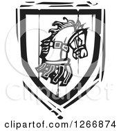 Clipart Of A Black And White Woodcut Heraldic Horse Shield Royalty Free Vector Illustration by xunantunich