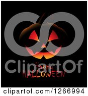 Lit Jackolantern Pumpkin Over Happy Halloween Text On Black