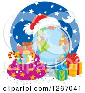 Clipart Of A Christmas Desk Globe With A Santa Hat Sack And Presents Royalty Free Vector Illustration