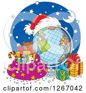 Clipart Of A Christmas Desk Globe With A Santa Hat Sack And Gifts Royalty Free Vector Illustration