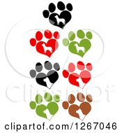 Clipart Of White Silhouetted Dogs In Heart Shaped Paw Prints Royalty Free Vector Illustration