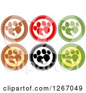 Clipart Of Circles Of Silhouetted Dog Heads In Heart Shaped Paw Prints Royalty Free Vector Illustration
