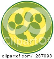 Clipart Of A Green And Yellow Circle Of A Silhouetted Dog Head In A Heart Shaped Paw Print Royalty Free Vector Illustration by Hit Toon