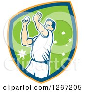 Clipart Of A Retro Male Cricket Player Fast Bowler Throwing A Ball In An Orange Blue And Green Shield Royalty Free Vector Illustration