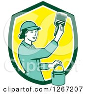 Clipart Of A Retro Female House Painter Using A Brush In A Green White And Yellow Shield Royalty Free Vector Illustration by patrimonio