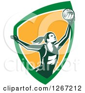 Clipart Of A Retro Female Volleyball Or Netball Player Serving In A Green White And Orange Shield Royalty Free Vector Illustration