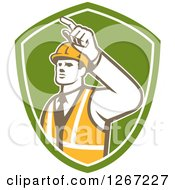 Clipart Of A Retro Male Construction Builder Foreman Pointing In A Green And White Shield Royalty Free Vector Illustration