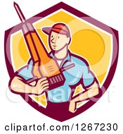Clipart Of A Cartoon White Male Construction Worker Holding A Jackhammer In A Maroon White And Yellow Shield Royalty Free Vector Illustration