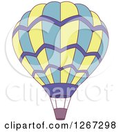 Clipart Of A Yellow Blue And Purple Hot Air Balloon Royalty Free Vector Illustration