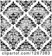 Clipart Of A Seamless Pattern Background Of Vintage Black And White Ornate Floral Damask Royalty Free Vector Illustration by Vector Tradition SM