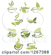 Clipart Of Two Toned Hot Green Tea Cups And Leaves Royalty Free Vector Illustration