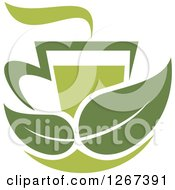 Poster, Art Print Of Two Toned Steamy Hot Green Tea Cup And Green Leaves