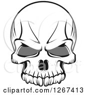 Clipart Of A Black And White Human Skull With A Stern Expression Royalty Free Vector Illustration