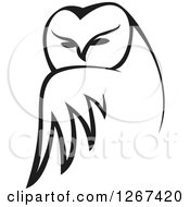 Clipart Of A Black And White Owl Looking Over Its Wing Royalty Free Vector Illustration