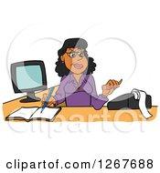 Black Female Bookkeeper Using A Calculator At Her Desk