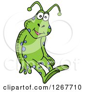 Clipart Of A Spotted Blue And Green Stuffed Alien Toy Royalty Free Vector Illustration by LaffToon