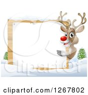 Clipart Of A Happy Rudolph Red Nosed Reindeer Pointing Around A Blank Sign In The Snow Royalty Free Vector Illustration