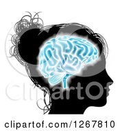 Clipart Of A Silhouetted Womans Head With A Glowing Blue Brain Royalty Free Vector Illustration