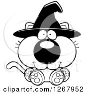 Clipart Of A Black And White Happy Halloween Witch Cat Sitting Royalty Free Vector Illustration