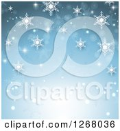 Clipart Of A Blue Christmas Background With Snowflakes And Light Royalty Free Vector Illustration