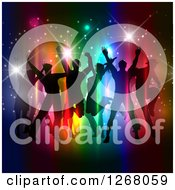 Clipart Of A Silhouetted Group Of People Dancing And Jumping Over Colorful Lights And Flares Royalty Free Vector Illustration