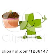 Clipart Of A 3d Happy Green Pharmaceutical Cross Character Holding Up A Finger And A Chocolate Frosted Cupcake Royalty Free Illustration by Julos