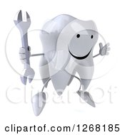 Clipart Of A 3d Happy Tooth Character Jumping And Holding A Wrench Royalty Free Illustration by Julos