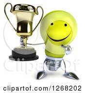 Clipart Of A 3d Happy Yellow Light Bulb Character Pointing To And Holding A Trophy Royalty Free Illustration