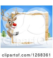 Clipart Of A Rudolph Red Nosed Reindeer Pointing Around A Wood Sign In The Snow Against Blue Sky Royalty Free Vector Illustration