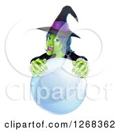 Clipart Of A Green Halloween Witch Behind A Crystal Ball Royalty Free Vector Illustration