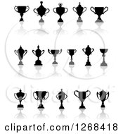 Clipart Of Black Silhouetted Trophy Cups Urns And Reflections Royalty Free Vector Illustration