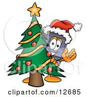 Clipart Picture Of A Suitcase Cartoon Character Waving And Standing By A Decorated Christmas Tree