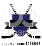 Clipart Of A Crossed Black And White Hockey Sticks Behind A Blue Shield With A Blank Black Banner Royalty Free Vector Illustration by Vector Tradition SM