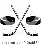 Clipart Of Black And White Hockey Pucks And Crossed Sticks Royalty Free Vector Illustration by Vector Tradition SM