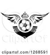 Clipart Of A Black And White Winged Soccer Ball With A Crown And Blank V Shaped Banner Royalty Free Vector Illustration by Vector Tradition SM