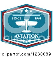 Clipart Of A Red White And Blue Shield Airplane Design With Sample Text Royalty Free Vector Illustration by Seamartini Graphics