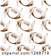 Clipart Of A Seamless Background Pattern Of Spinning Brown American Footballs Royalty Free Vector Illustration by Seamartini Graphics