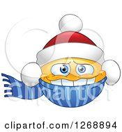 Clipart Of A Cold Smiley Emoticon Bundled In A Christmas Santa Hat And Scarf Royalty Free Vector Illustration by yayayoyo