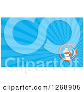 Clipart Of A Retro Batting Baseball Player And Blue Ray Business Card Design Royalty Free Illustration