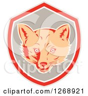 Clipart Of A Retro Fox Face In A Gray Red And White Shield Royalty Free Vector Illustration by patrimonio