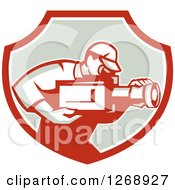 Clipart Of A Retro Cameraman Filming In A Red White And Taupe Shield Royalty Free Vector Illustration