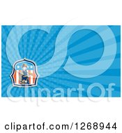 Clipart Of A Retro Fireman Holding An Axe Over A Blue Ray Business Card Design Royalty Free Illustration