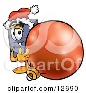 Clipart Picture Of A Suitcase Cartoon Character Wearing A Santa Hat Standing With A Christmas Bauble