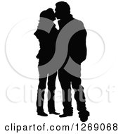 Clipart Of A Black Silhouette Of A Couple Standing And Kissing Royalty Free Vector Illustration