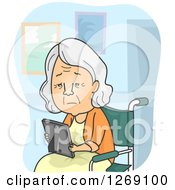 Sad Senior Caucasian Woman Looking At A Picture And Sitting In A Wheelchair In A Nursing Home