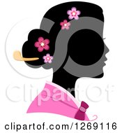 Clipart Of A Silhouetted Black Korean Womans Face With A Colored Kimono And Blossoms In Her Hair Royalty Free Vector Illustration by BNP Design Studio