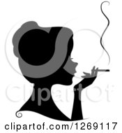 Clipart Of A Silhouetted Black Womans Face And Hand With A Smoking Cigarette Royalty Free Vector Illustration
